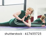smiling pretty yoga instructor... | Shutterstock . vector #617655725