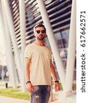 stylish man posing in...   Shutterstock . vector #617662571
