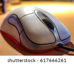 wired computer mouse on the... | Shutterstock . vector #617666261