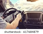 man holding the steering wheel... | Shutterstock . vector #617684879