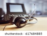 voip headset headphones and... | Shutterstock . vector #617684885