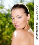 Beautiful caucasian woman with  moisturizer cream on shoulder - stock photo