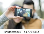 young couple takes a selfie | Shutterstock . vector #617714315