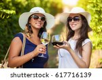 happy girls toasting with... | Shutterstock . vector #617716139