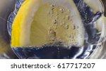 a slice of lemon dipped in... | Shutterstock . vector #617717207