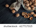 some walnuts on a black wooden... | Shutterstock . vector #617717315