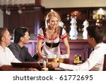 the waitress brings the beer to ... | Shutterstock . vector #61772695