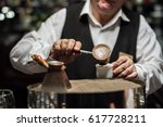 a man cooks on the sand  coffee ... | Shutterstock . vector #617728211