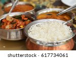 indian curry meal with balti... | Shutterstock . vector #617734061