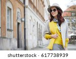 fashionable woman in a hat ... | Shutterstock . vector #617738939