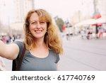 portrait of smiling 40 years... | Shutterstock . vector #617740769