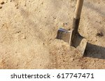 old shovel with wooden handle... | Shutterstock . vector #617747471