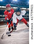 ice hockey sport young boys... | Shutterstock . vector #617759021