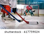 ice hockey player in action... | Shutterstock . vector #617759024
