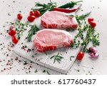 raw pork loin chops on a... | Shutterstock . vector #617760437