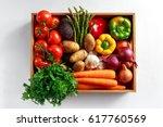 fresh vegetables in wooden box... | Shutterstock . vector #617760569