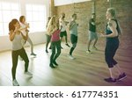 people exercising with trainer...   Shutterstock . vector #617774351