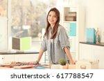 young creative designer working ... | Shutterstock . vector #617788547