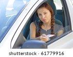 beautiful woman show her driver'... | Shutterstock . vector #61779916