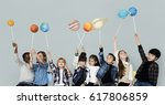 diverse group of kids holding... | Shutterstock . vector #617806859