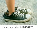 kid wearing adult shoes | Shutterstock . vector #617808725