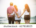 love triangle  man is hugging a ... | Shutterstock . vector #617818025