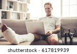 handsome mature man with broken ... | Shutterstock . vector #617819939