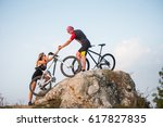bicyclist pulls the hand woman... | Shutterstock . vector #617827835