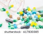 medicine pills or capsules on... | Shutterstock . vector #617830385