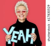 Small photo of Woman Smiling Happiness Holding Comic Word Yeah Portrait