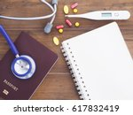 close up stethoscope  passport  ... | Shutterstock . vector #617832419