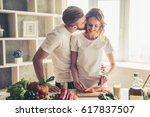 beautiful young couple is... | Shutterstock . vector #617837507