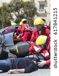 Small photo of Thessaloniki , Greece - April 9, 2017: First aid, victim liberation in an car accident and helmet removal demonstration by the Hellenic Red Cross rescue team
