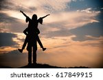 silhouette of couple love on... | Shutterstock . vector #617849915