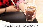 woman drinking cola | Shutterstock . vector #617854511
