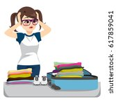 desperate young woman packing... | Shutterstock .eps vector #617859041