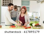 happy young family preparing... | Shutterstock . vector #617895179