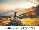 man raised hands at sunset... | Shutterstock . vector #617915729