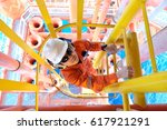 Small photo of Operator climb up from well head slot to inspect and check abnormal condition of process in the oil and gas central processing platform.