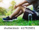 athlete resting on green glass... | Shutterstock . vector #617925851
