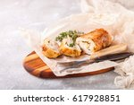 Small photo of Chicken roll and vegetables on a table. Selective focus. Copy space
