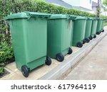 row of green plastic bin | Shutterstock . vector #617964119