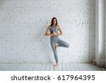 Young Woman Doing Yoga  Tree...