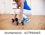 athletic girl doing fit in gym | Shutterstock . vector #617966465