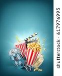 popcorn  cinema reel ...   Shutterstock . vector #617976995