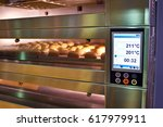 lcd screen of oven with bread... | Shutterstock . vector #617979911