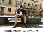 man sits with cup of coffee... | Shutterstock . vector #617993375