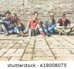 group of trendy friends using... | Shutterstock . vector #618008075
