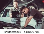 handsome mechanics in uniform... | Shutterstock . vector #618009701