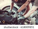 handsome mechanics in uniform... | Shutterstock . vector #618009851
